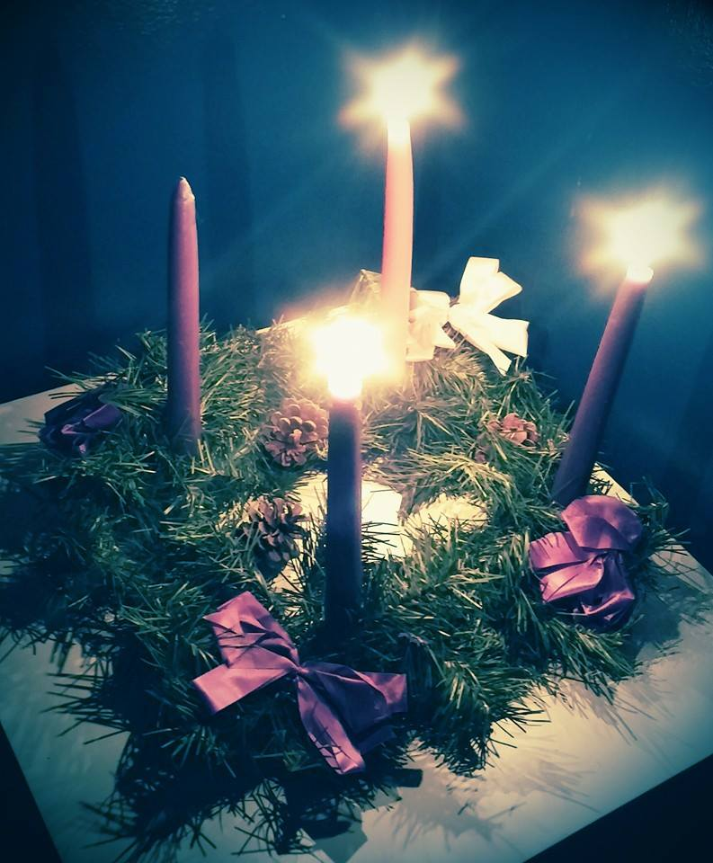 Our Advent wreath last Sunday with three candles lit.