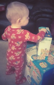 My 15-month-old son on Christmas morning with some of his loot