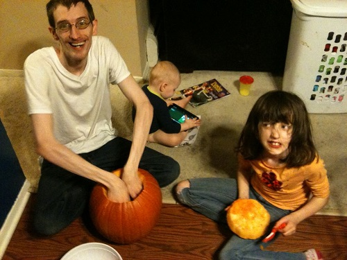 My brother & the kids carving the pumpkin